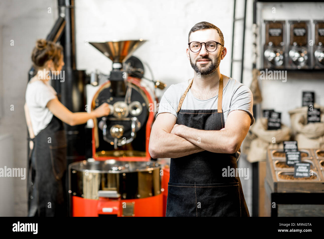 Barista portrait in the coffee shop - Stock Image