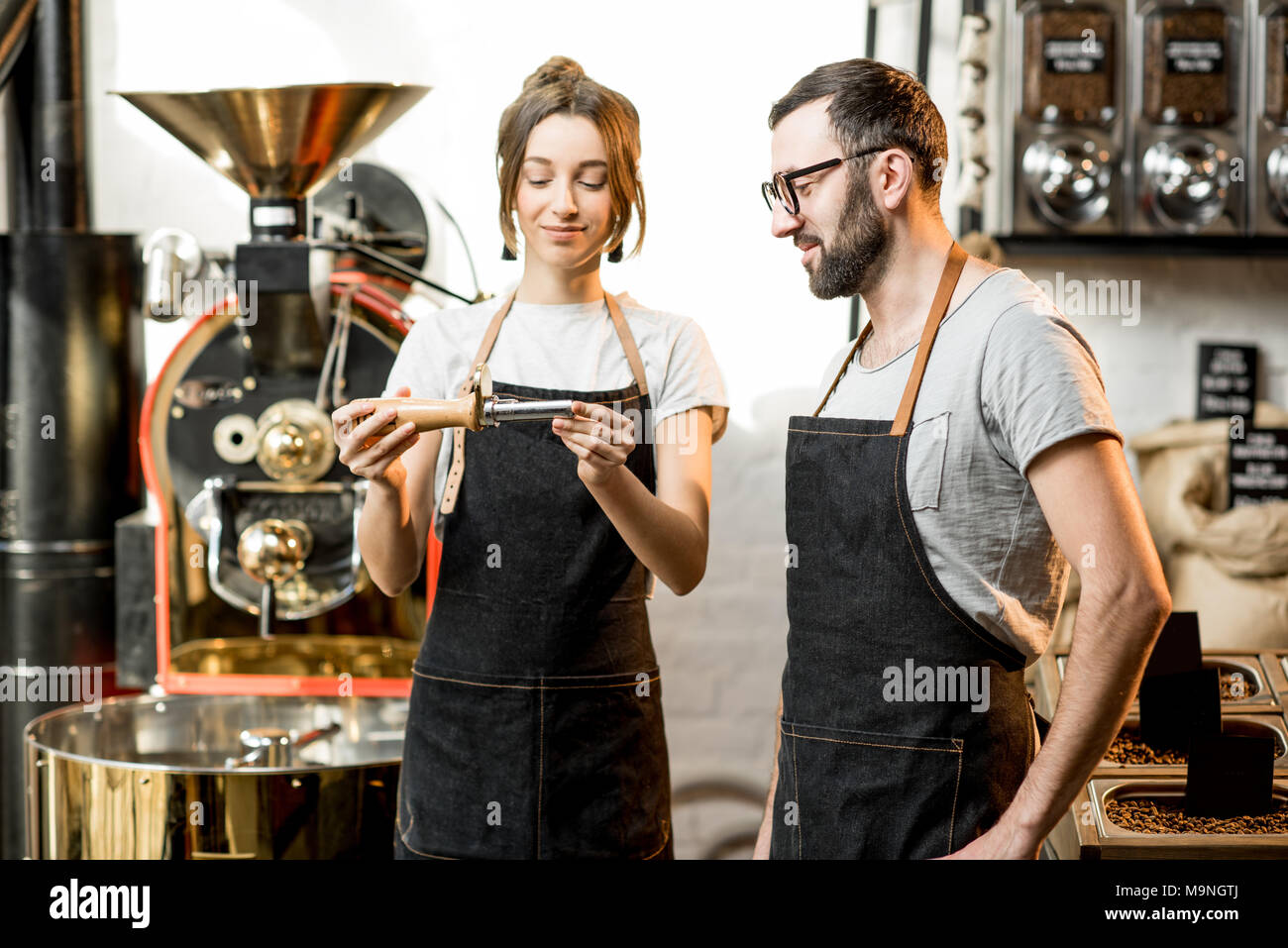 Baristas checking the quality of coffee - Stock Image