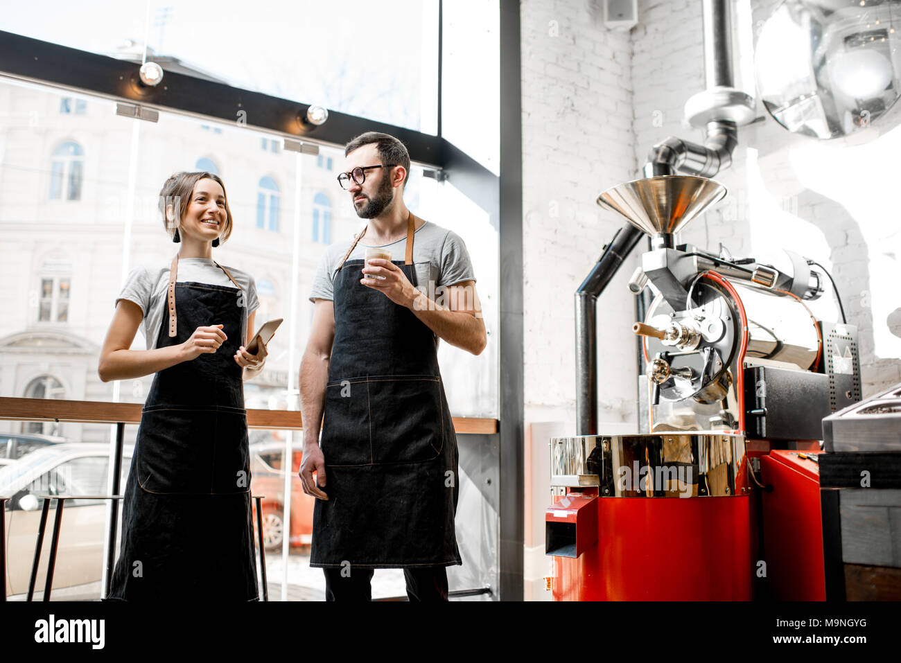 Baristas talking in the coffee shop - Stock Image