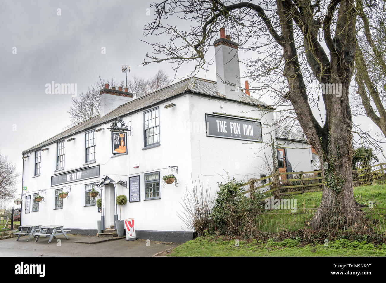 The Fox inn, starting point for an annual pie scramble ritual and then the bottle (small kegs of beer) kicking contest against the neighboring village Stock Photo