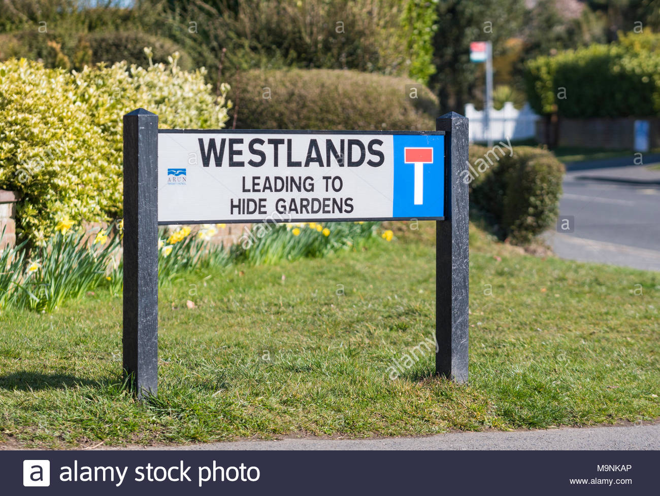Street name sign with no through road symbol in the UK. - Stock Image