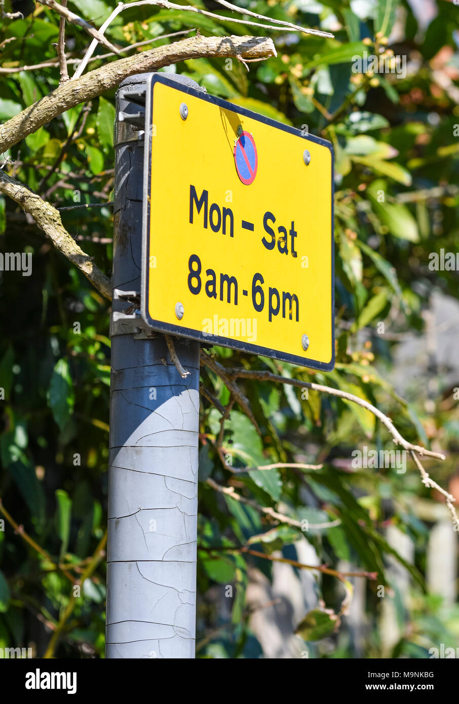 No parking mon-sat sign on the roadside in the UK. - Stock Image
