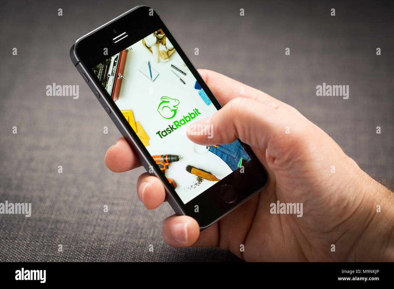 Task Rabbit app on an iPhone - Stock Image