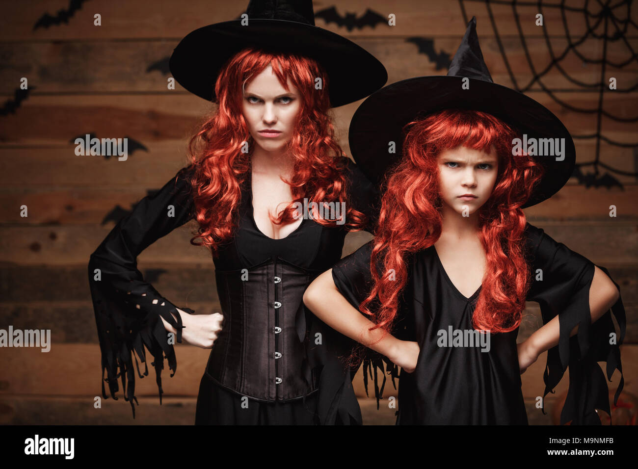 Halloween Concept - Beautiful caucasian mother and her daughter with long red hair in witch costumes  sc 1 st  Alamy & Red Costumes Face Stock Photos u0026 Red Costumes Face Stock Images - Alamy
