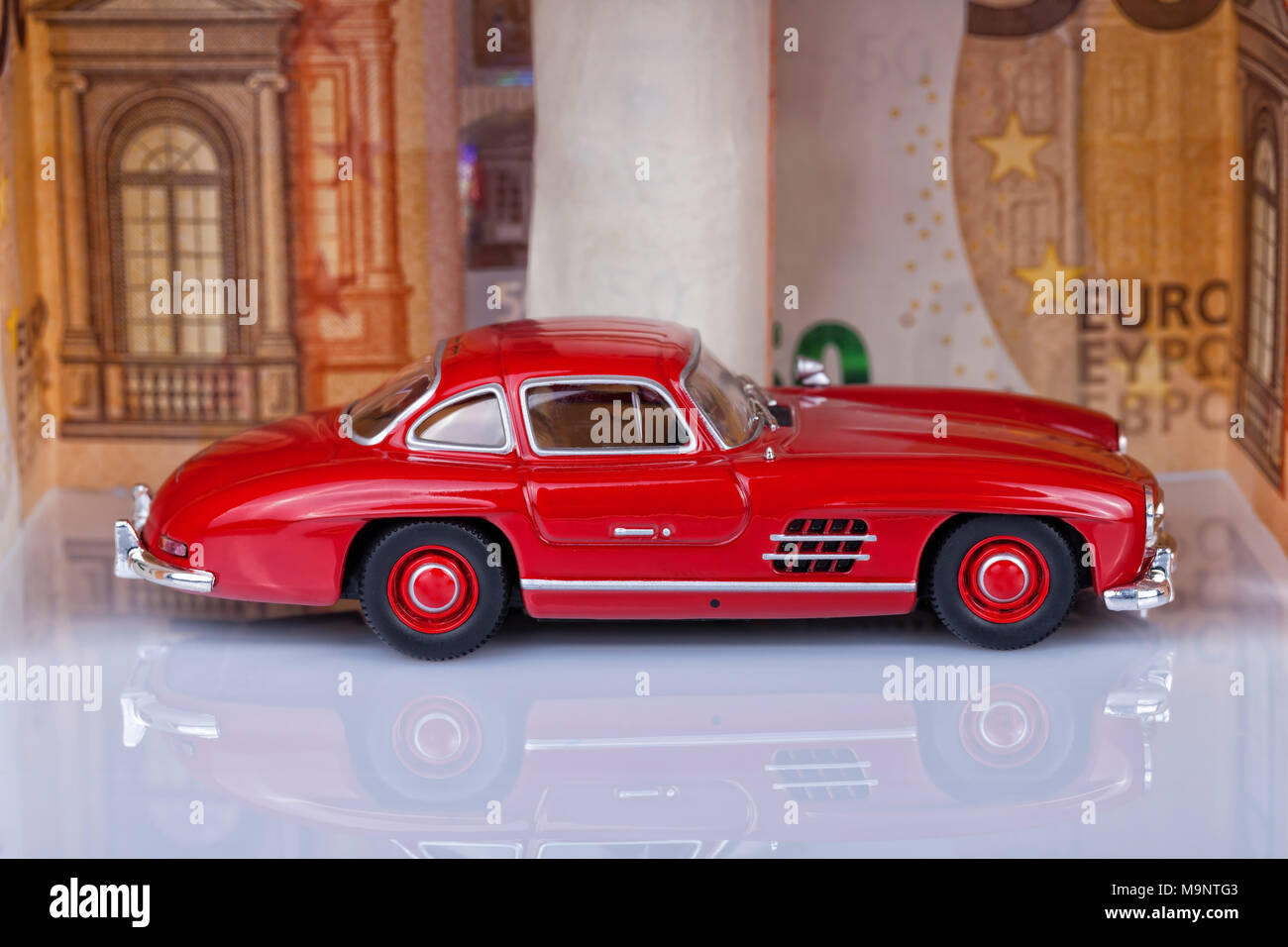 A Classic Sports Car Of The Year 1954 Of Red Color Inside A Garage