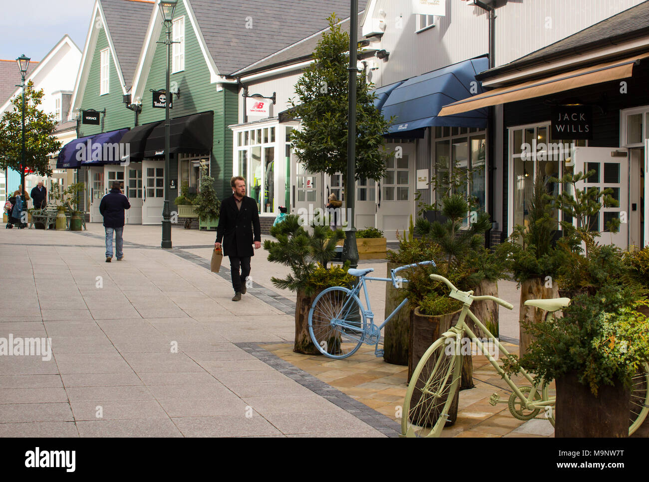 Shoppers walking around the many shops at the exclusive retail outlet centre at Ireland's up market Kildare Village - Stock Image