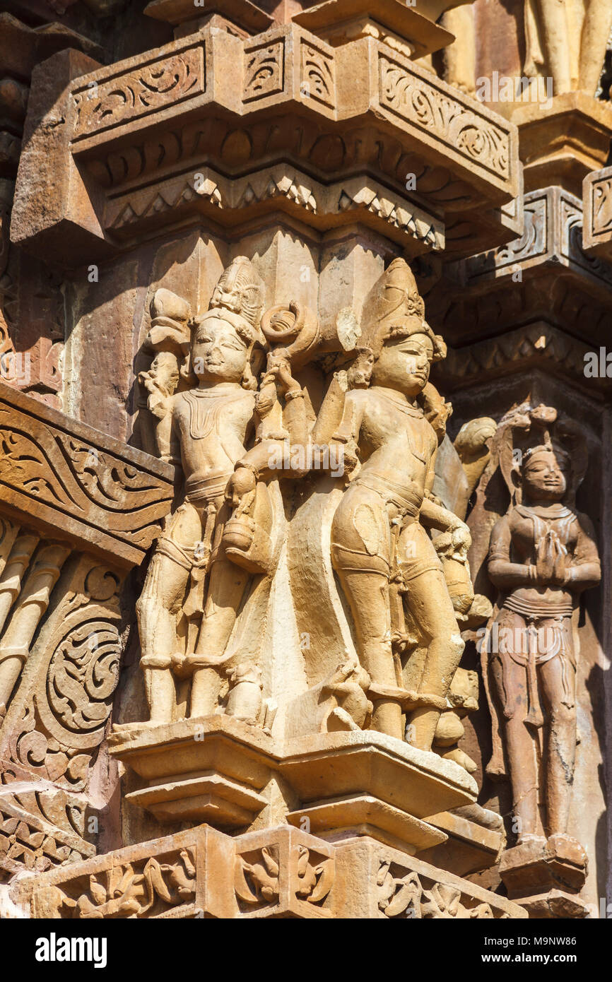 Ancient carvings of figures at a Hindu temple in the Western Group of the Khajuraho Group of Monuments at Khajuraho, Madhya Pradesh, India - Stock Image