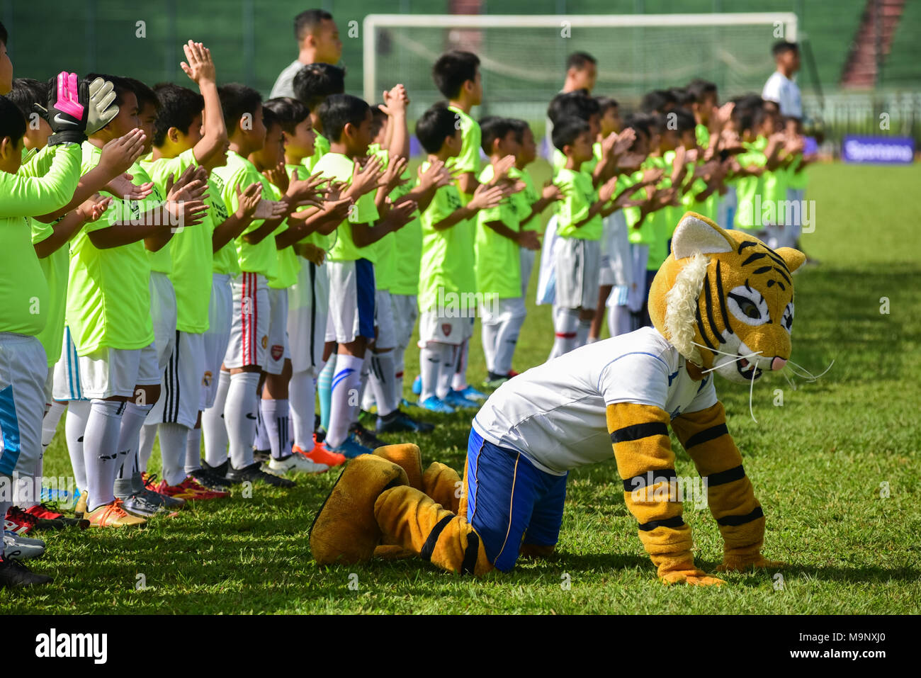 Football academy trainees greet audience before an exhibition match against five players of Persib Bandung to celebrate the club's 85th anniversary. Stock Photo