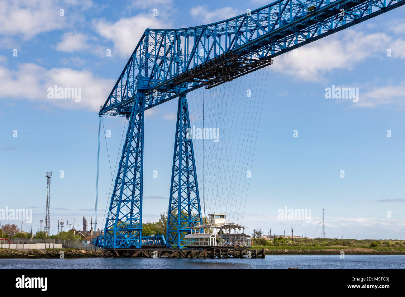 Middlesbrough, England, UK - May 14, 2016: View towards the transporter bridge with a gondola passing the River Tees - Stock Image