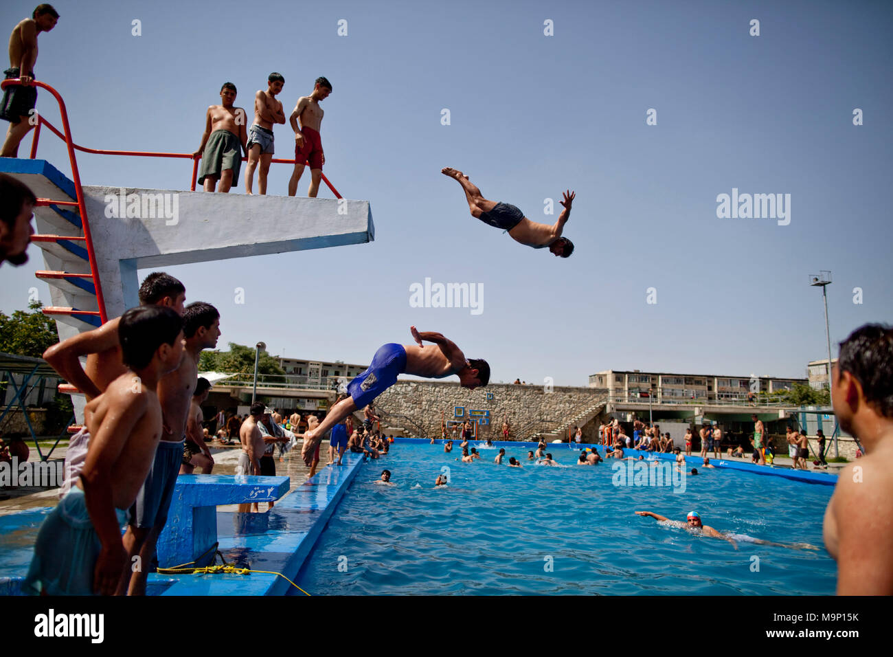 Afghan men and boys enjoy a day at the pool in Kabul, Afghanistan, Friday, July 17, 2009. - Stock Image