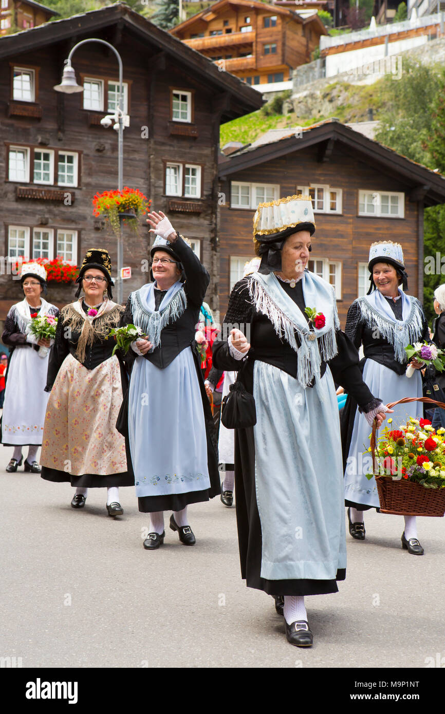 Women in traditional Swiss dresses on parade in Zermatt, Valais Canton, Switzerland - Stock Image