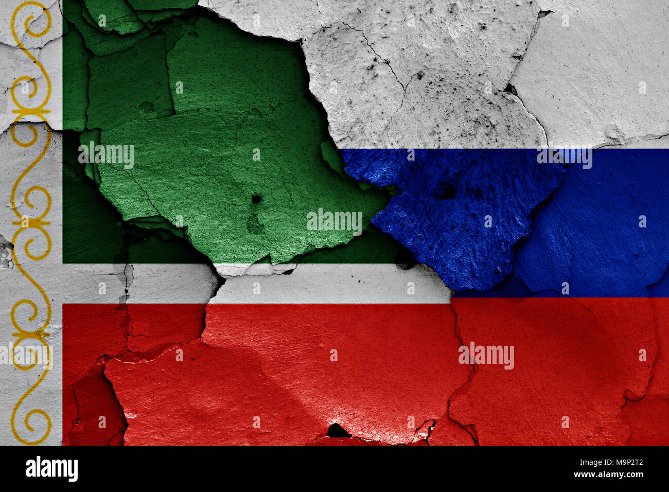 flags of Chechnya and Russia painted on cracked wall - Stock Image