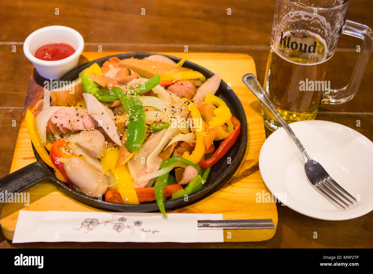 A typical dish of South Korea to eat with beer after skiing: grilled sausage and sweet peppers.  The Alpensia Resort is a ski resort and a tourist attraction. It is located on the territory of the township of Daegwallyeong-myeon, in the county of Pyeongchang, hosting the Winter Olympics in February 2018.  The ski resort is approximately 2.5 hours from Seoul or Incheon Airport by car, predominantly all motorway.   Alpensia has six slopes for skiing and snowboarding, with runs up to 1.4 km (0.87 mi) long, for beginners and advanced skiers, and an area reserved for snowboarders. While the resort Stock Photo