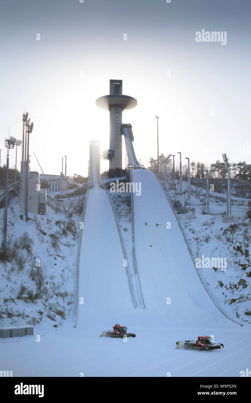 Alpensia Ski Jumping Stadium is a multi-purpose stadium located at Alpensia Resort in Pyeongchang, South Korea. It will host ski jumping events during the 2018 Winter Olympics.     The Alpensia Resort is a ski resort and a tourist attraction. It is located on the territory of the township of Daegwallyeong-myeon, in the county of Pyeongchang, hosting the Winter Olympics in February 2018.    The ski resort is approximately 2.5 hours from Seoul or Incheon Airport by car, predominantly all motorway.     Alpensia has six slopes for skiing and snowboarding, with runs up to 1.4 km (0.87 mi) long, - Stock Image