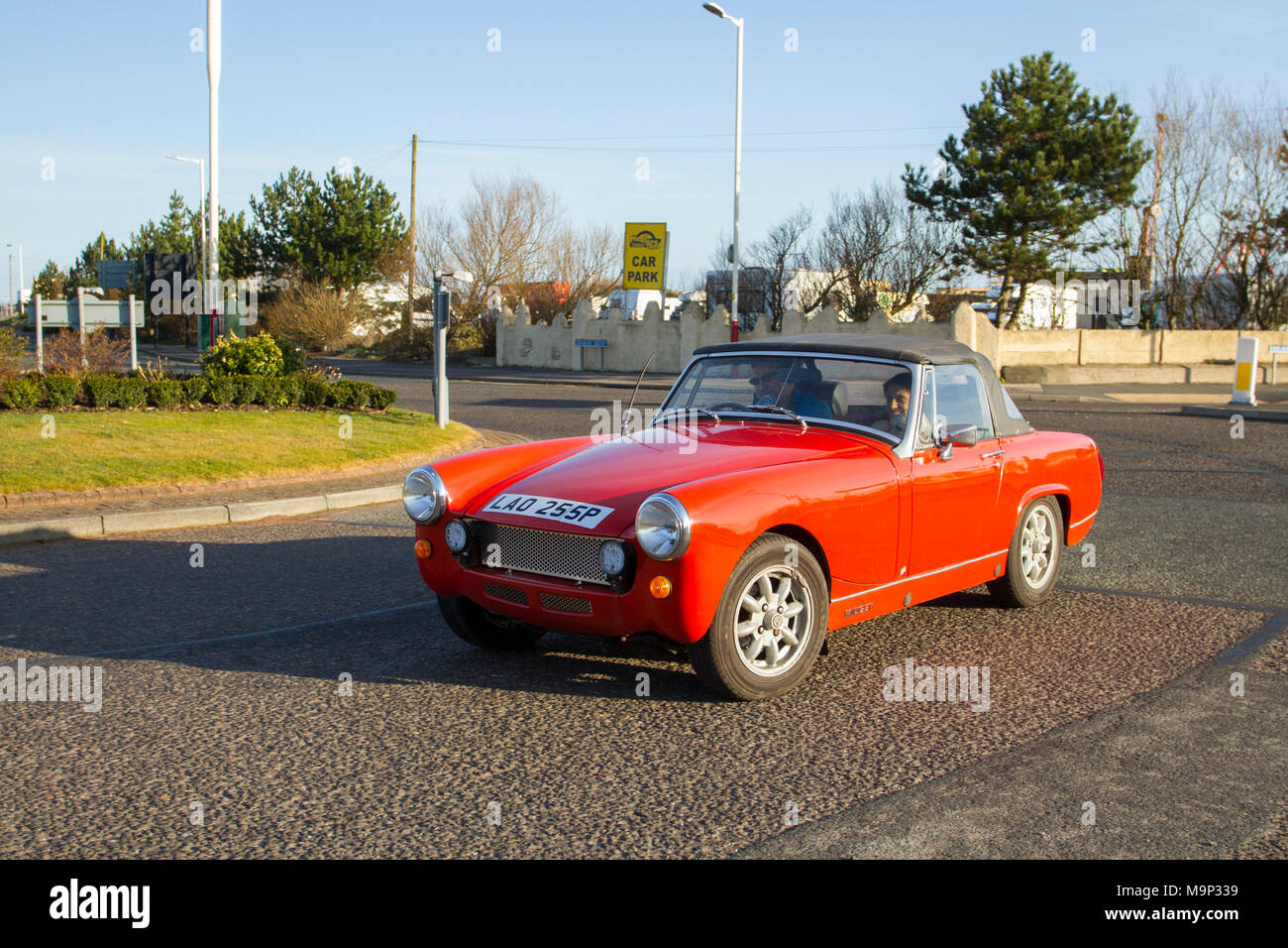 North-West Supercar event as hundreds of cars and tourists arrive in the coastal resort on a warm spring day. SuperCars are bumper to bumper on the seafront esplanade as classic & vintage car enthusiasts enjoy a motoring day out. - Stock Image