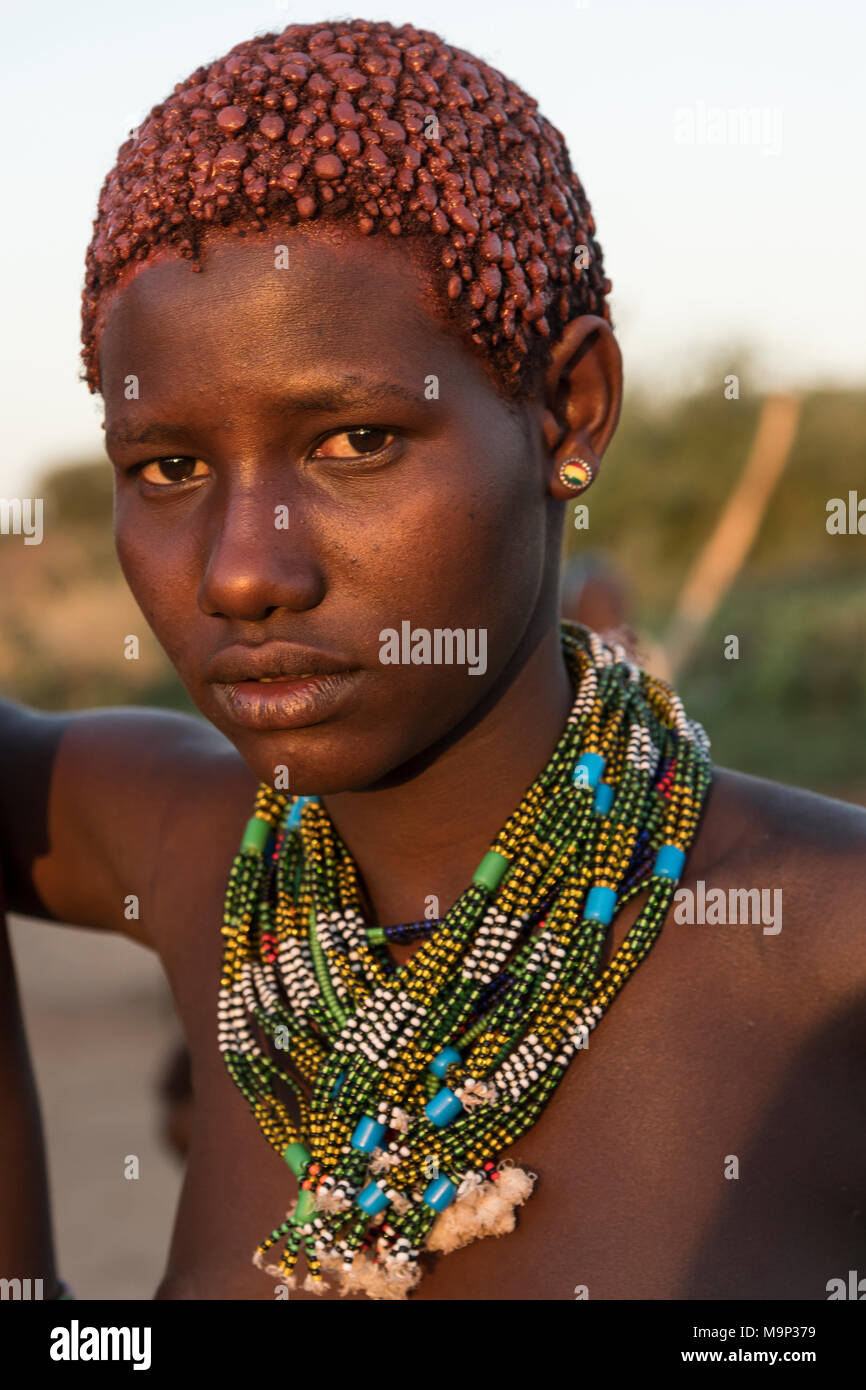 Girl with necklace approx. 16 years, Hamer tribe, portrait, Turmi, region of southern nations, nationalities and peoples - Stock Image