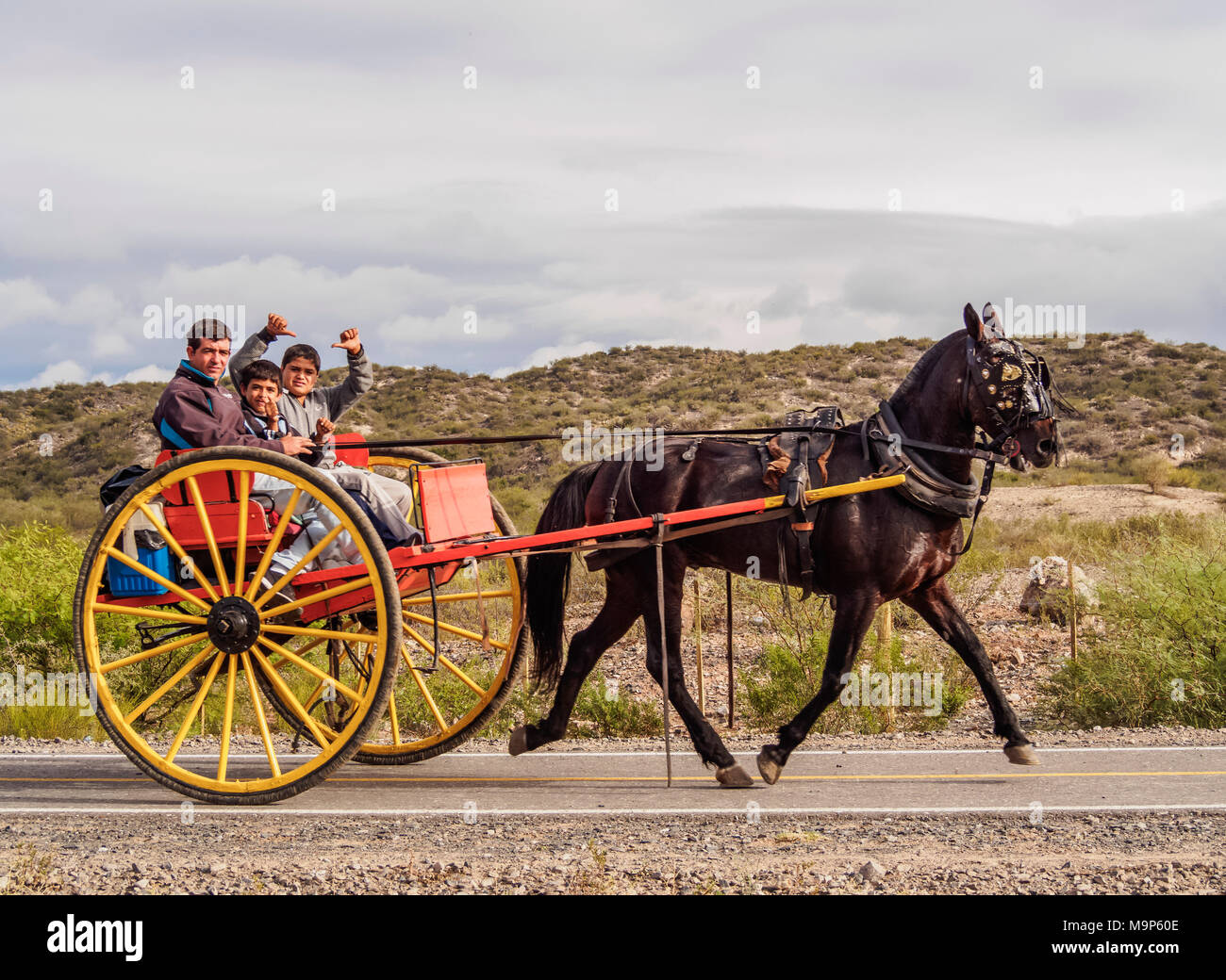 Gauchos on the horse carriage, Vallecito, San Juan Province, Argentina - Stock Image