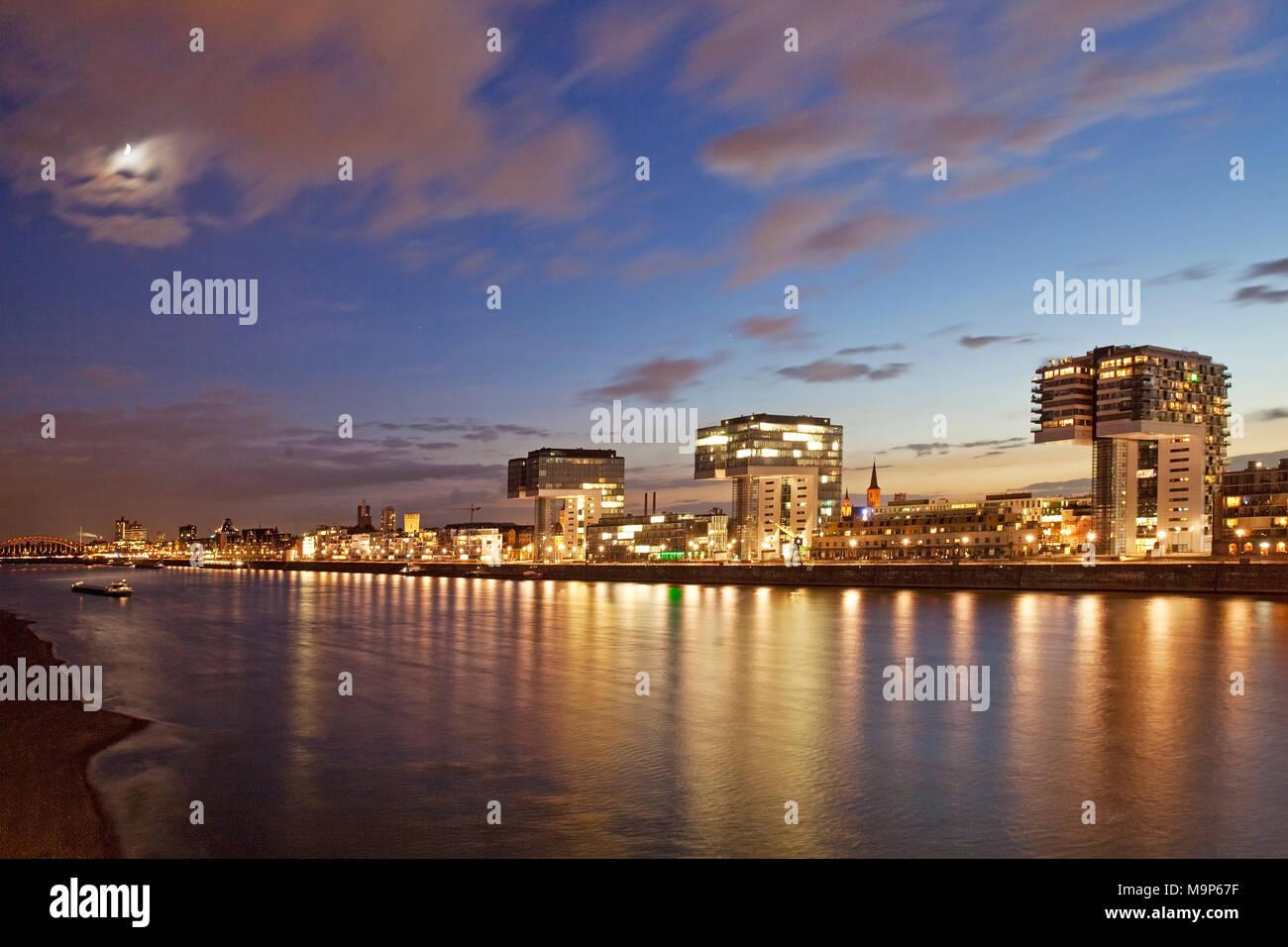 Kranhaeuser mit Rhein und Mond am Abend, Koeln, Rheinland, Nordrhein-Westfalen, Deutschland, Europa - Stock Image