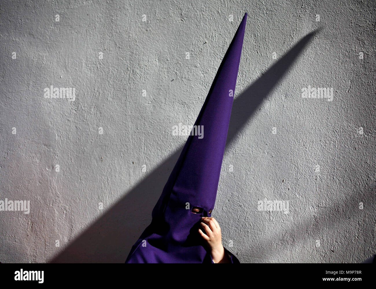 Penitent wearing pointed hood during Easter Week celebrations in Baeza, Jaen Province, Andalusia, Spain - Stock Image
