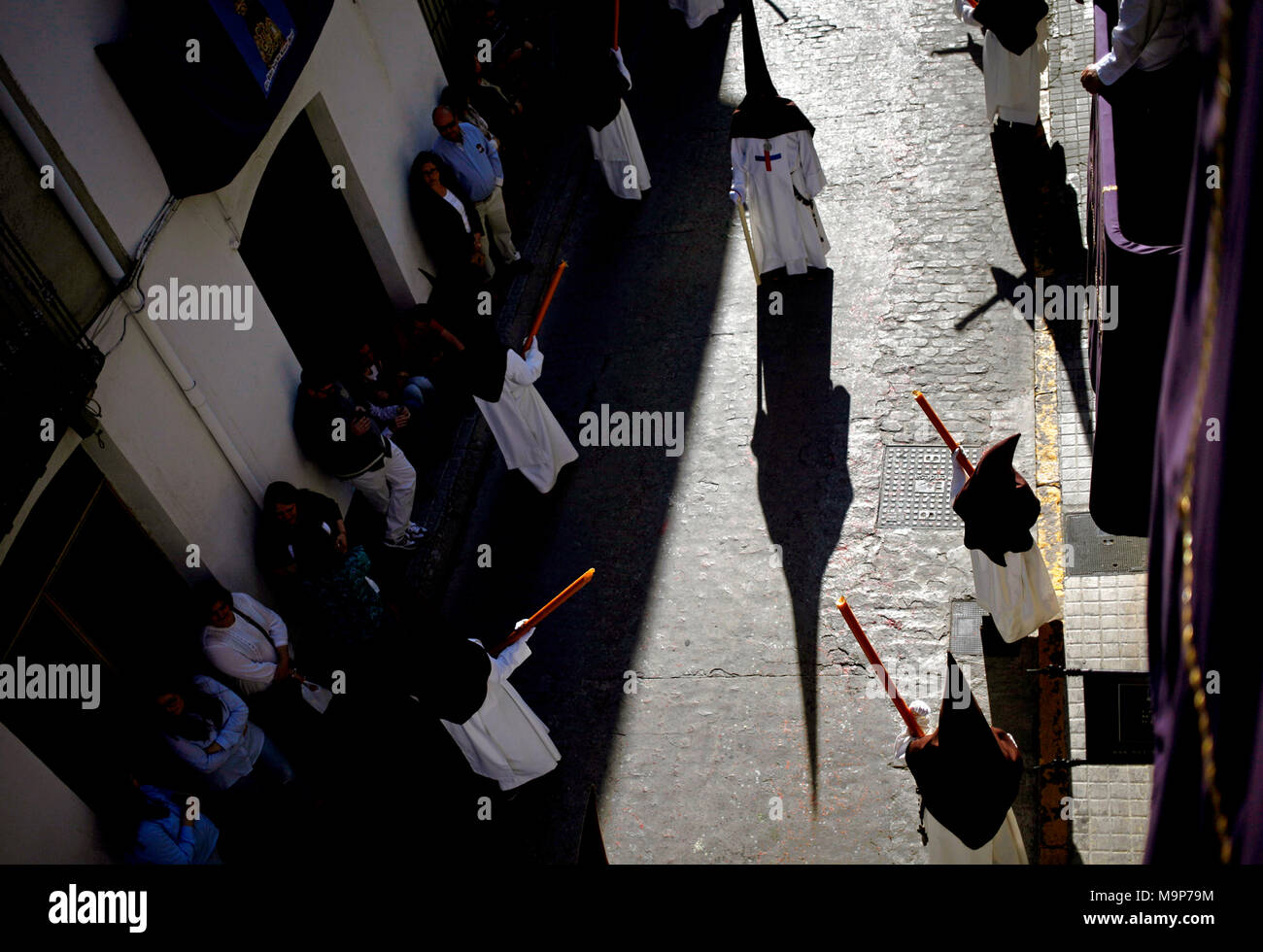 Shadow of penitente during Easter Week celebrations in Baeza, Jaen Province, Andalusia, Spain - Stock Image