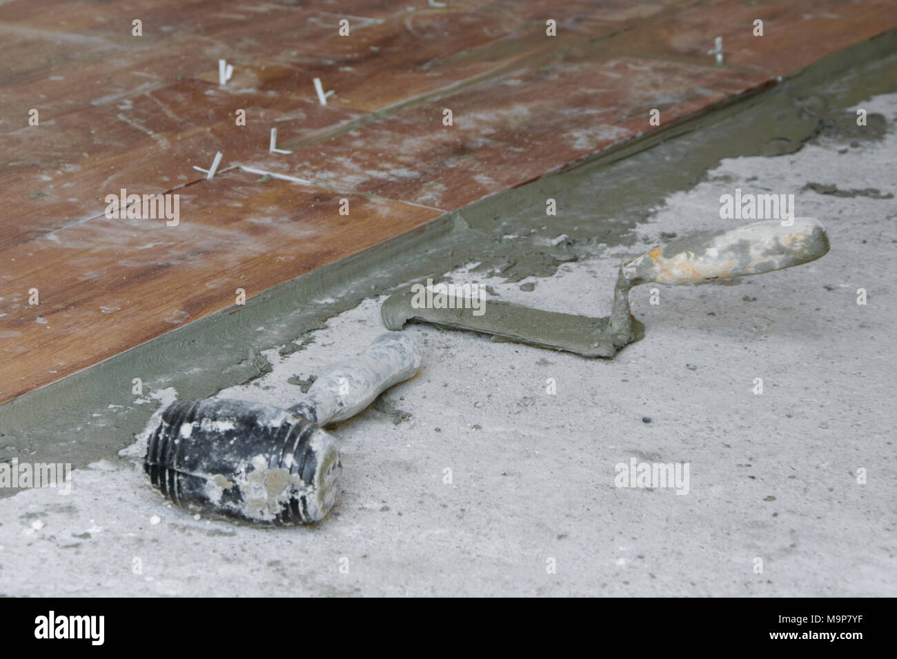 Ceramic tiles tools tiler floor stock photos ceramic tiles tools tools for laying tiles on floor at construction site industry building concept stock image dailygadgetfo Image collections