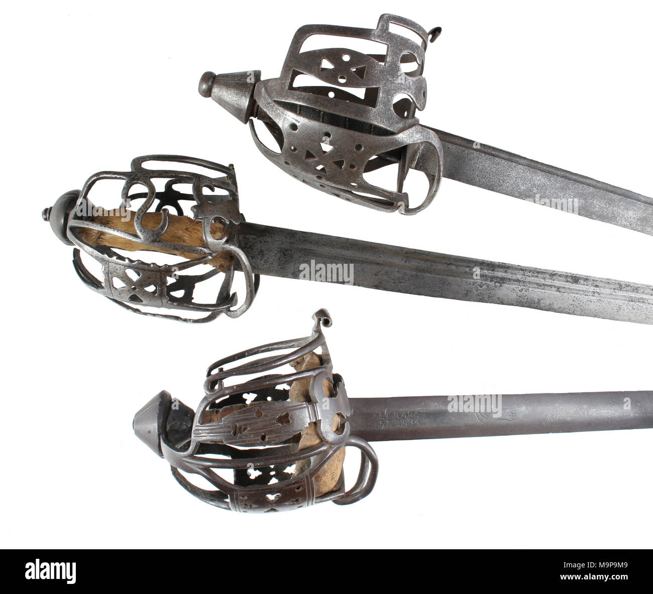 Three Steel  basket hilts of 18th Century Scottish Highland broadswords of the types used in the American Revolution - Stock Image