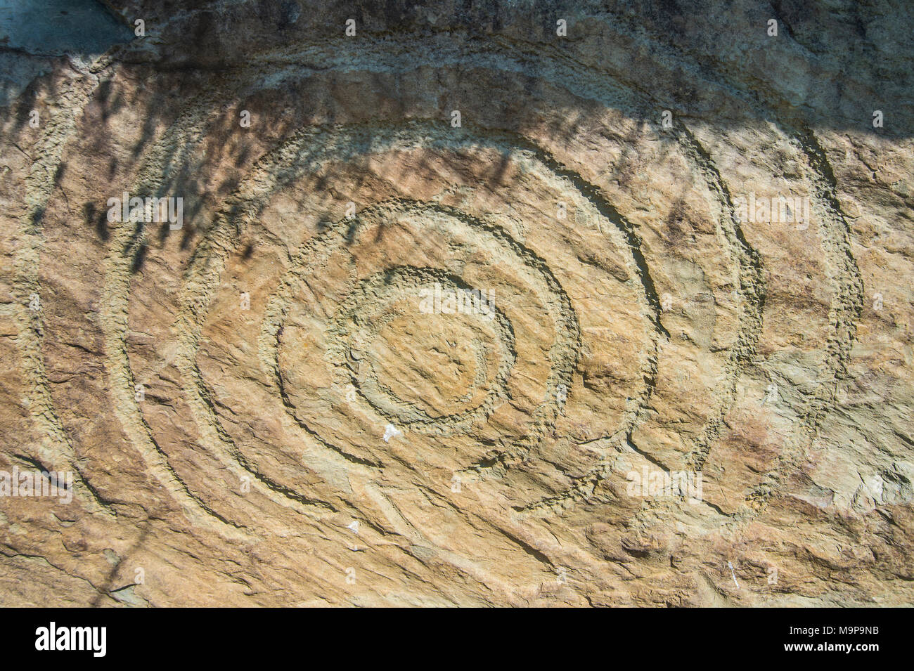 Rock engraving on Neolithic passage grave, Knowth,Unesco world heritage sight, prehstoric Bru na Boinne, Ireland Stock Photo