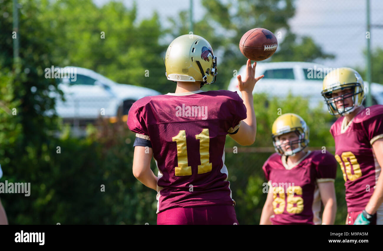 Pass at American Football game on field - Stock Image