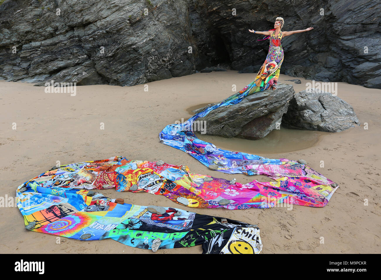 Emma Adsams wears a dress made out of 100 discarded bodyboards to highlight the impact of beach waste on the marine environment. The dress has a 72 fo - Stock Image