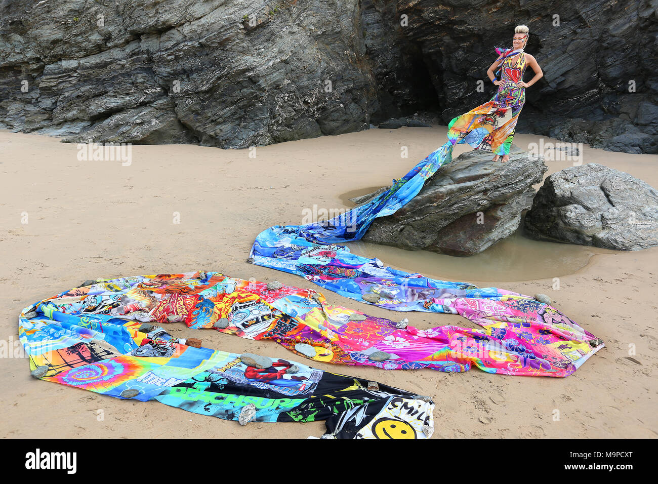 Emma Adams wears a dress made out of 100 discarded bodyboards to highlight the impact of beach waste on the marine environment. The dress has a 72 foo - Stock Image