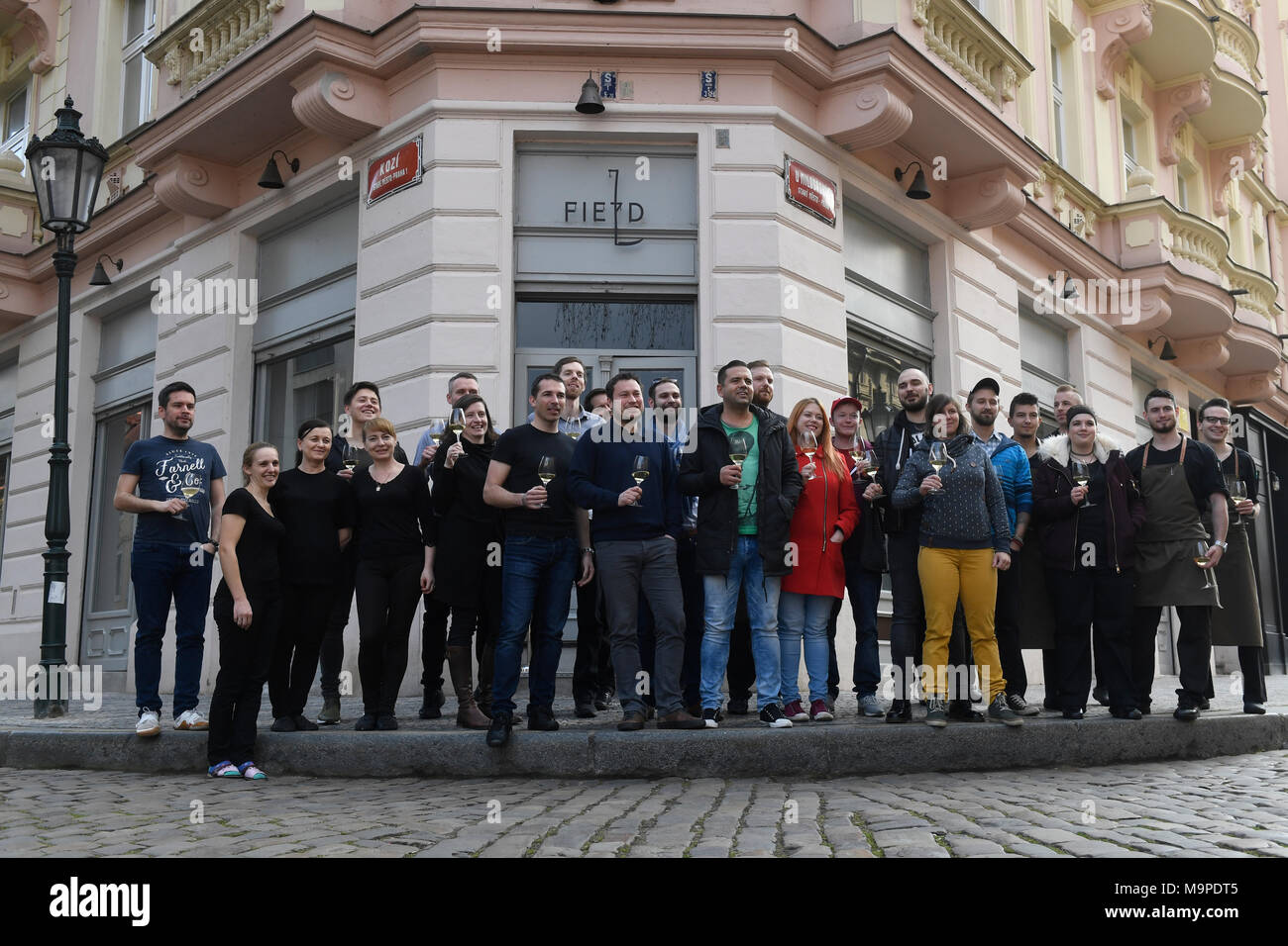 Prague, Czech Republic. 27th Mar, 2018. Two restaurants in Prague with Czech chefs, La Degustation Boheme Bourgeoise and Field, have defended their Michelin stars, while Alcron has lost it in this year. On the photo is seen Chef of Field restaurant Radek Kasparek with his employees in front of the restaurant in Prague, Czech Republic, on March 27, 2018. Credit: Michal Krumphanzl/CTK Photo/Alamy Live News - Stock Image