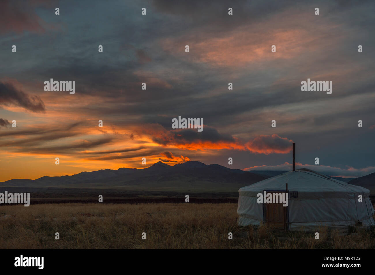Yurt under dramatical sunset, Mongolia - Stock Image