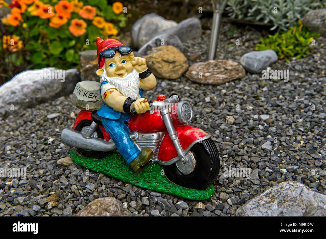 Garden gnome Rocker on motorcycle, Engelberg, Canton Obwalden, Switzerland Stock Photo