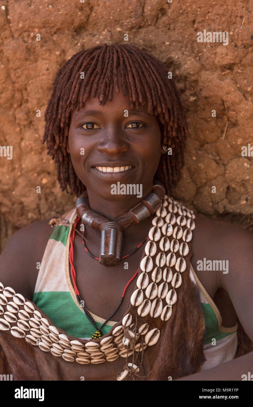 Woman, smiling, portrait, Hamer tribe, Turmi market, Southern Nations Nationalities and Peoples' Region, Ethiopia - Stock Image