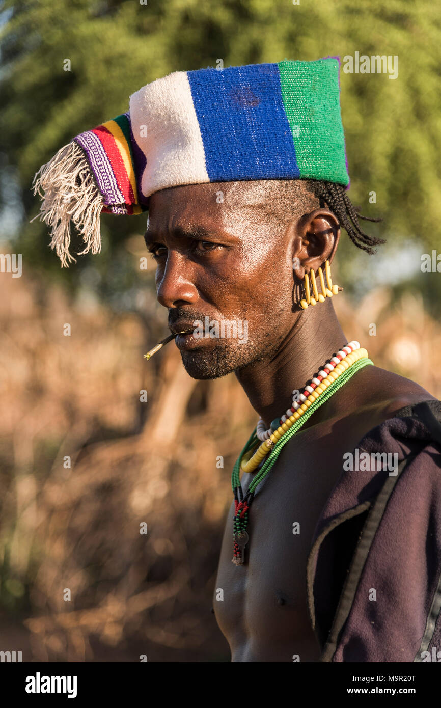 Man with colorful headgear, Hamer tribe, Turmi market, Southern Nations Nationalities and Peoples' Region, Ethiopia - Stock Image