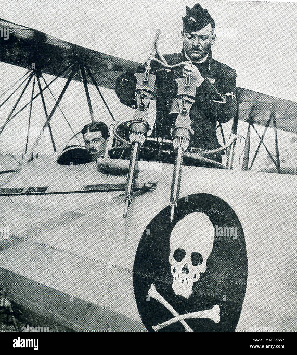 This photo dates to World War I and shows a French war plane. The captions says: A French reconnoitering machine with two machine guns joined together on a turret behind the pilot. - Stock Image