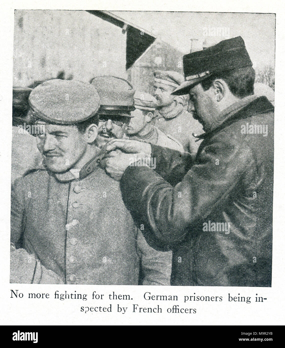 This photo dates to World War I and shows German prisoners. The caption says: No more fighting for them. German prisoners being inspected by French officers. - Stock Image