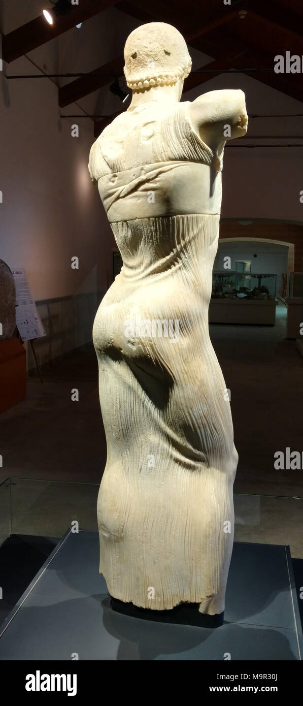 This photo dates to March 2018 in Palermo in Sicily. It shows the Motya Charioteer, which dates to around 350 B.C. It is a rare example of a Greek victor's statue and is believed to represent a guy who won a chariot race some 2,500 years ago. It was found in 1979 off the tiny island of Motya off the western coast of Sicily. His long tunic identifies him as a charioteer. This photo shows the reverse side of the charioteer. - Stock Image