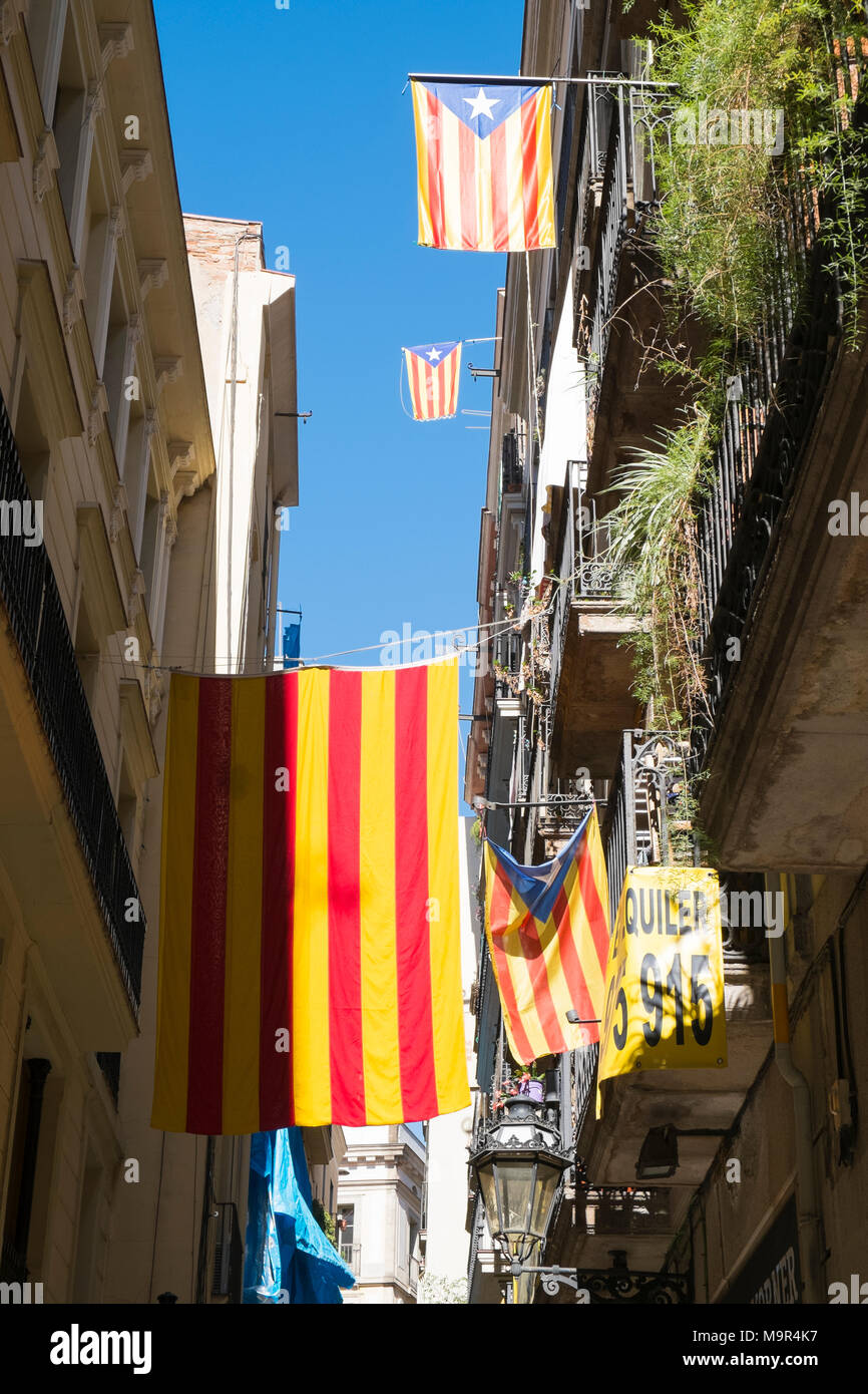 Catalonian flags hang from buildings in Barcelona, Spain - Stock Image