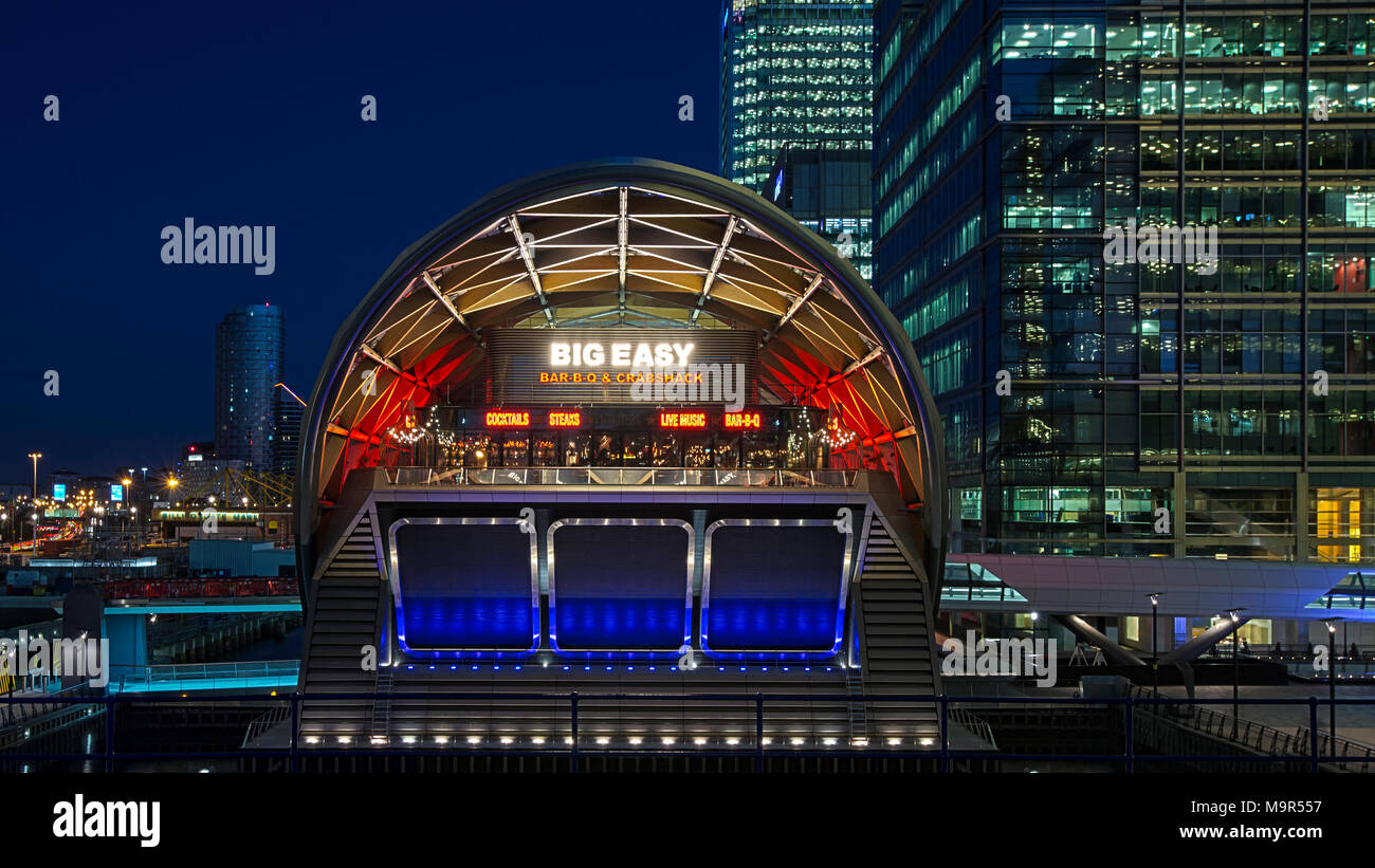 A view of Crossrail Place in the financial district of canary Wharf at night. London, UK. - Stock Image