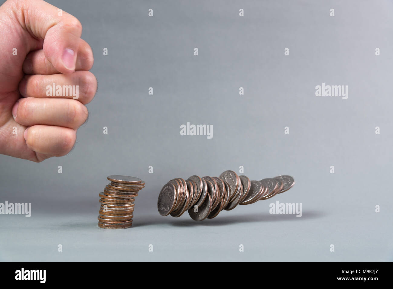 Hand Punch The Increasing Columns Of Coins On White