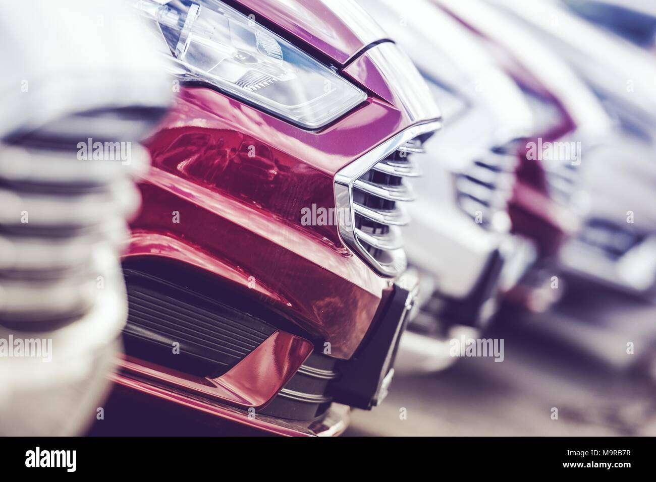 Automotive Industry Concept. New Cars Production Line. Brand New Vehicles on the Factory Lot. - Stock Image