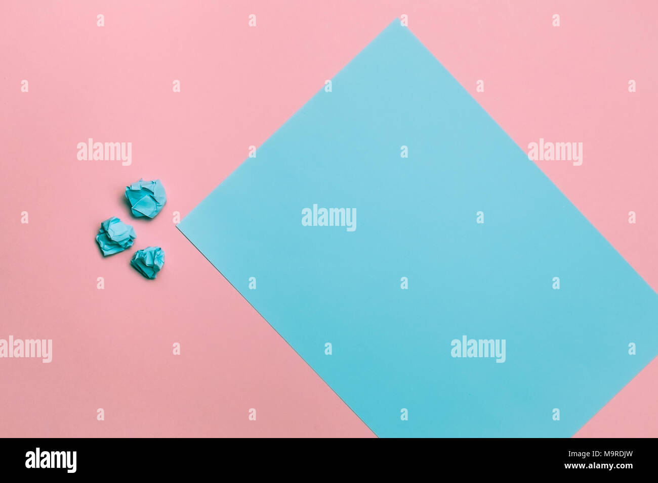 Two tone pink and blue contrast colored paper background with crumpled balls. Empty blank for text and design. - Stock Image