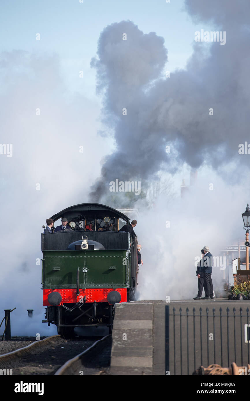 Portrait shot of UK steam locomotive in plumes of steam & smoke as crew prepare for a.m. departure from Severn Valley Railway's Kidderminster station. - Stock Image