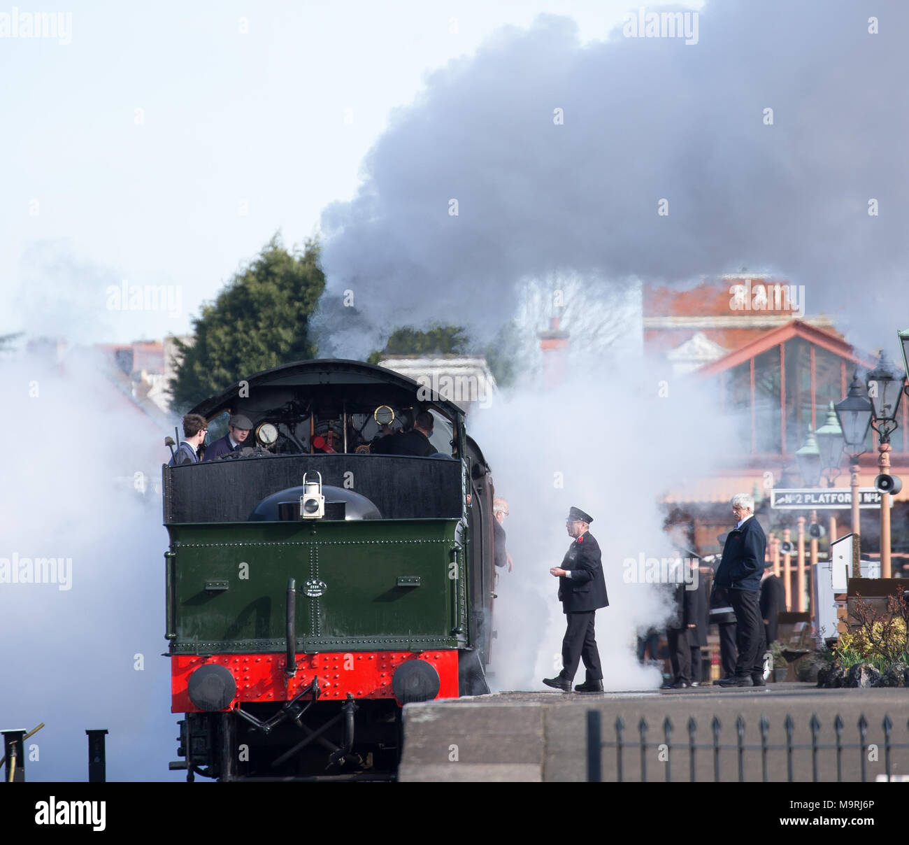 Landscape shot of UK steam locomotive in plumes of steam & smoke as crew prepare for a.m. departure from Severn Valley Railway's Kidderminster station. - Stock Image
