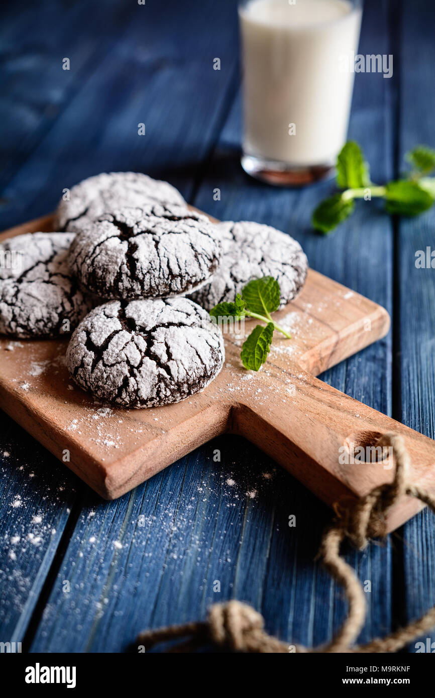 Chocolate crinkle cookies with powdered sugar icing - Stock Image