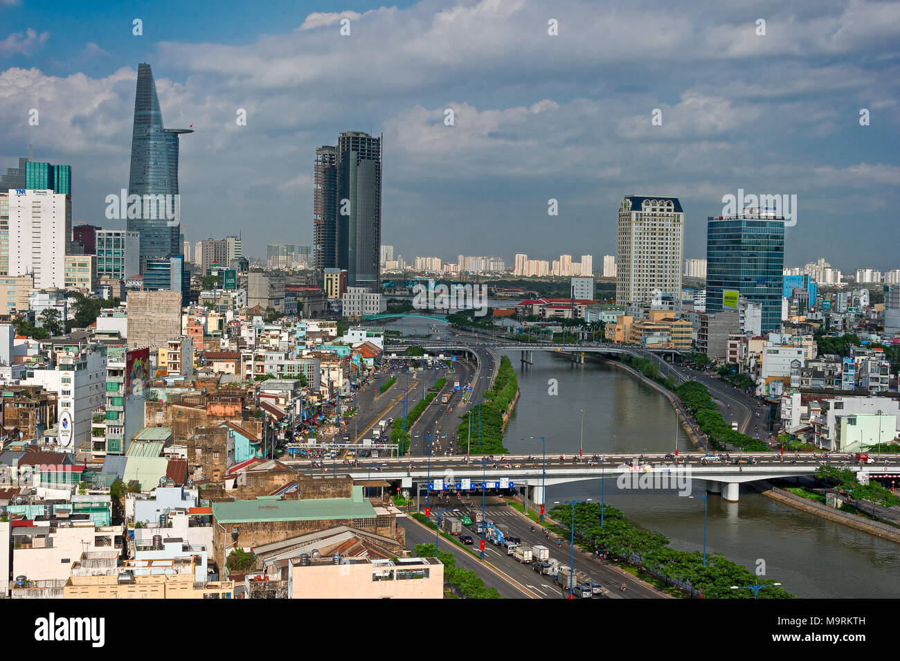 HO CHI MINH CITY, VIETNAM - APRIL 9, 2017: The sun sets over the Ho Chi Minh City skyline that mix the colonial and business district in Vietnam large Stock Photo