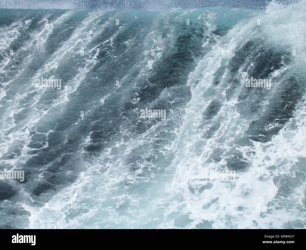 A large wind wave surges and collapses in northern Atlantic deep waters - Stock Image