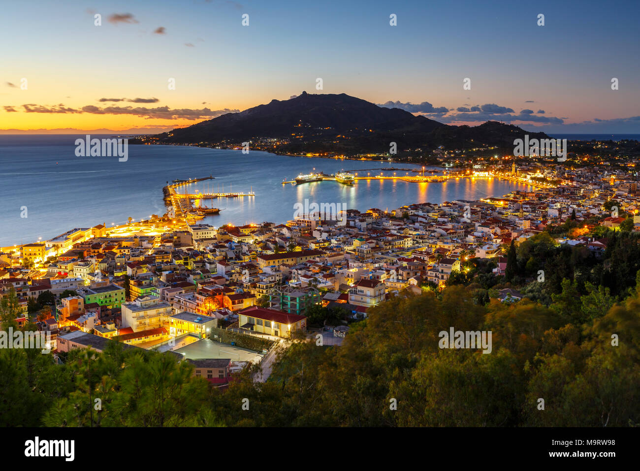 Sunrise over Zakynthos town and its harbour, Greece. - Stock Image