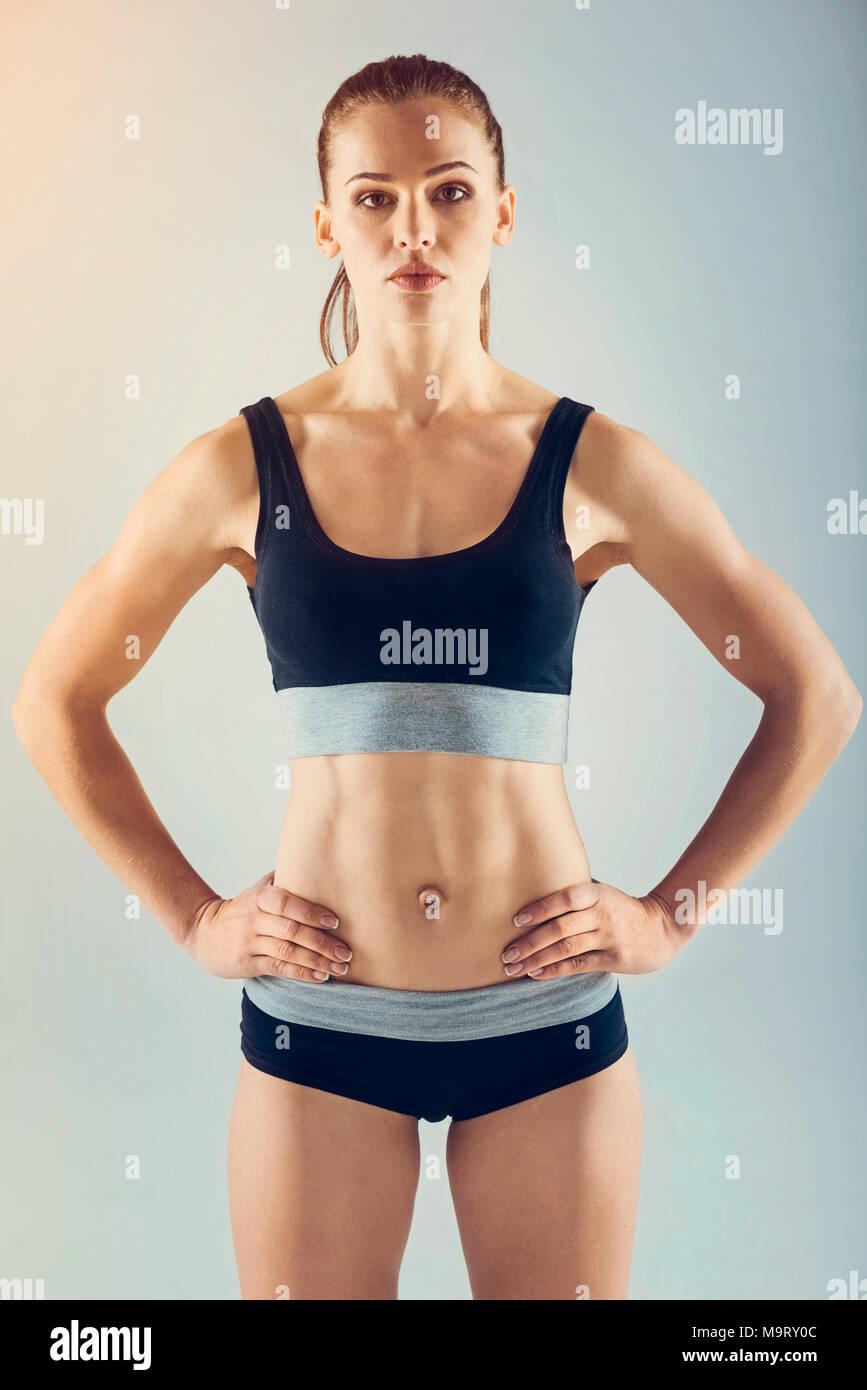 Sportswoman of unearthly beauty in sportswear looking into camera - Stock Image